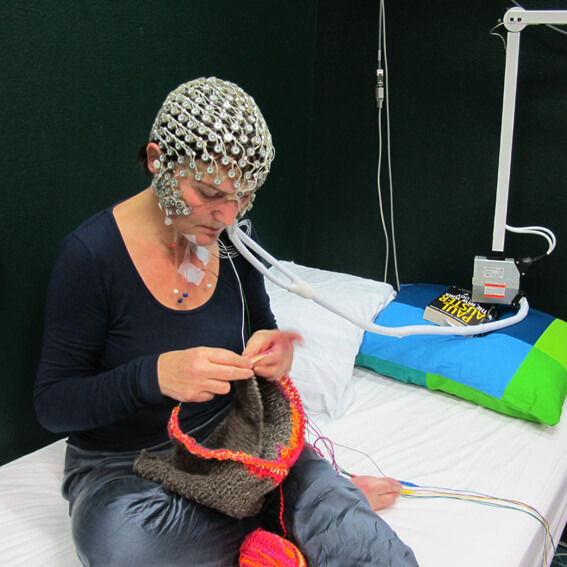 The author wired up at the Netherlands Institute for Neuroscience, mapping dexterity through scientific data for the Stitch Your Brain project. Photo: M. Auch.