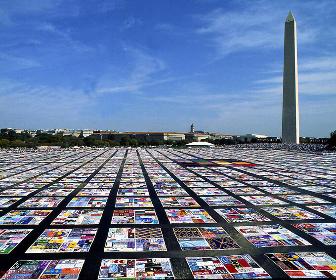 A gigantic tapestry of AIDS quilts in Washington D.C. The NAMES Project Foundation. Photo: M. Thiessen.